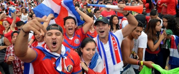 Costa Rica fans celebrate in San Jose on June 29, 2014 after their team defeated Greece in the Brazil 2014 FIFA World Cup Round of 16 football match and qualified for quarterfinals. AFP PHOTO/Ezequiel BECERRA