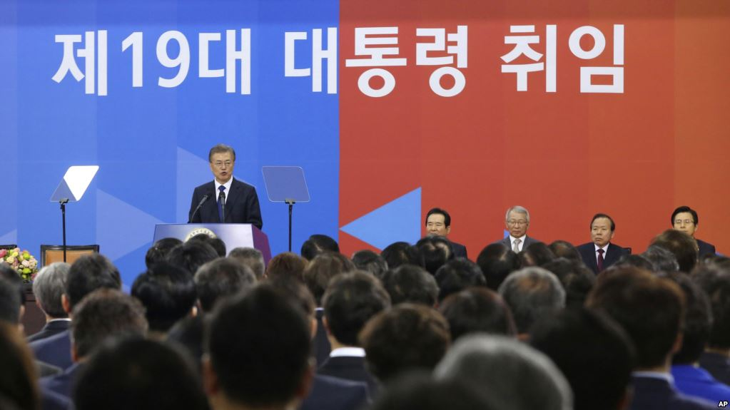 "Newly elected South Korean President Moon Jae-in, left, speaks during his inauguration ceremony at the National Assembly in Seoul, South Korea, Wednesday, May 10, 2017. The signs read "" The 19th President Inauguration Ceremony"".  (AP Photo/Ahn Young-joon. Pool)"