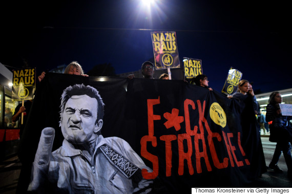 VIENNA, AUSTRIA - OCTOBER 13:  Demonstrators carry signs reading 'Nazis get out' and 'Fuck Strache!' during a protest on October 13, 2017 in Vienna, Austria. Austria will hold legislative elections on October 15 and the conservative party (OeVP) of Sebastian Kurze is currently in the lead. The right-wing Austria Freedom Party (FPOe) is currently in a strong, third place in polls. Since the Austrian Social Democrats (SPOe) have indicated they will likely decline from joining a coalition with the conservative OeVP, the next Austrian government could well be a coalition that includes the FPOe, a party that has taken a hard stance against immigration and Islam.  (Photo by Thomas Kronsteiner/Getty Images)
